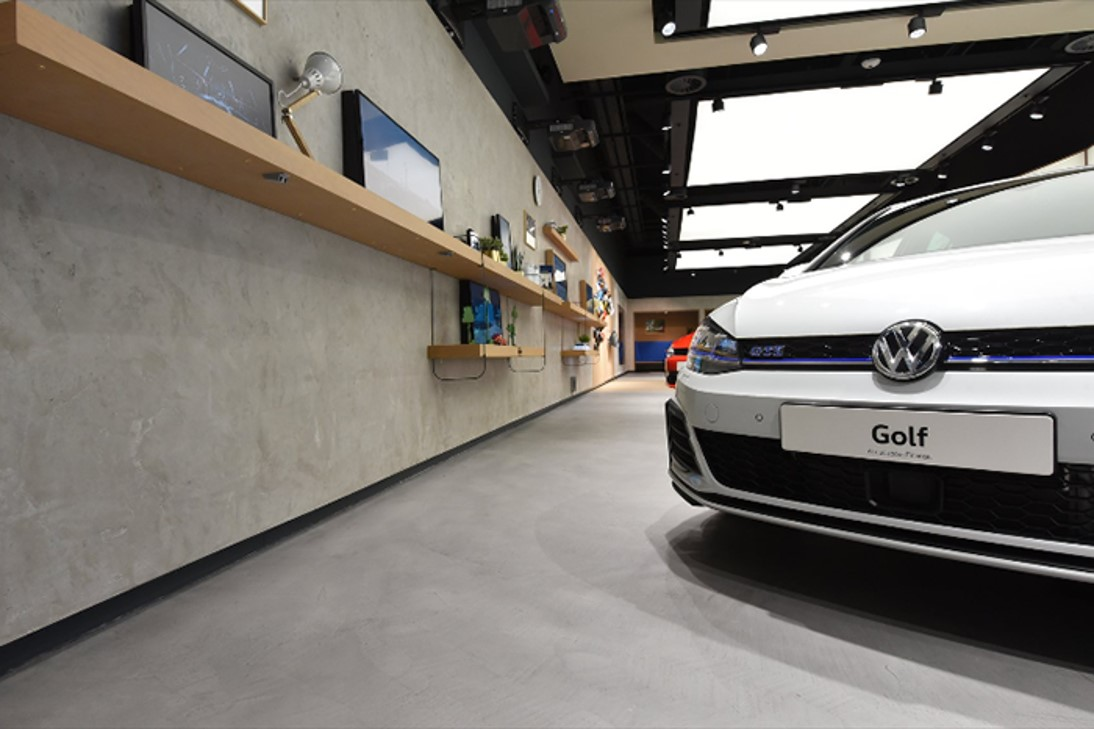 volkswagen polished concrete commercial floor in Ardex Pandomo loft