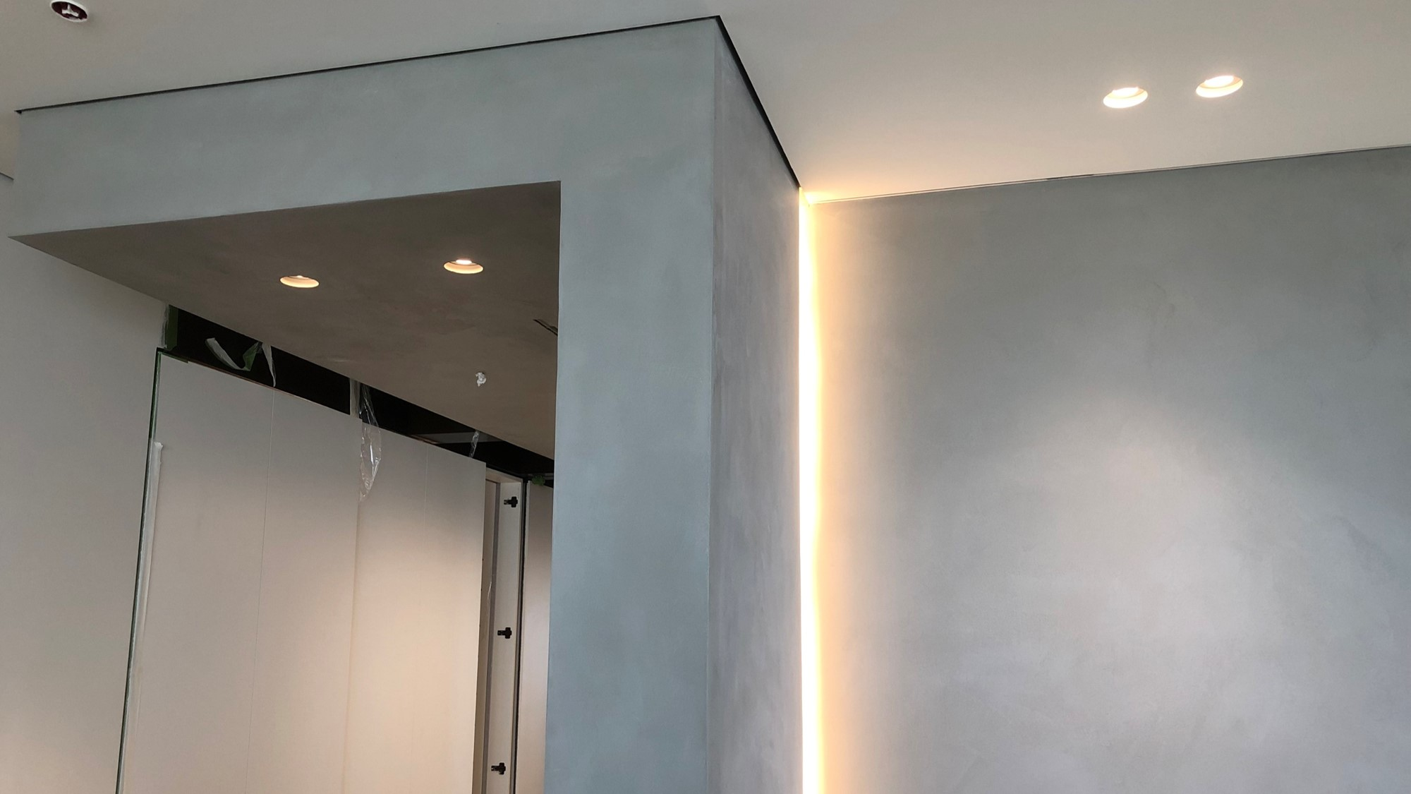 Polished concrete microtopping walls at luxury apartment in London Marylebone by Polished Concrete Specialists